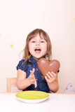 Enthusiastic little girl with chocolate heart stock photo