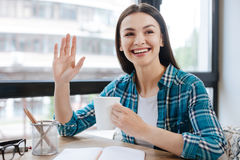 Enthusiastic lovely woman greeting her friend Stock Photography