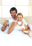 Enthusiastic lovers drinking coffee Stock Image