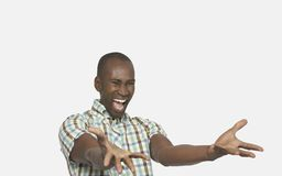 Enthusiastic Man Gesturing. Excited African American man gesturing over white background Royalty Free Stock Photos