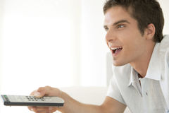 Enthusiastic Man with Remote Control royalty free stock photography