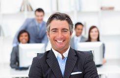 Enthusiastic manager and his team Royalty Free Stock Photo