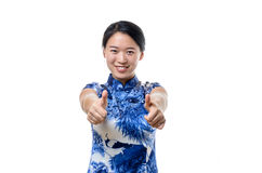 Enthusiastic motivated chinese woman giving a thumbs up Royalty Free Stock Photography