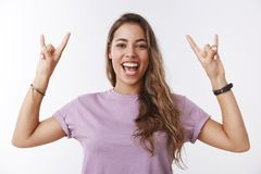 Enthusiastic optimistic happy charming caucasian 25s girl having fun enjoying awesome music concert relaxing friends. Smiling broadly showing tongue excited royalty free stock photography