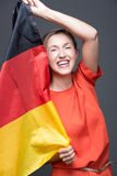Enthusiastic patriotic woman with the German flag Royalty Free Stock Photography