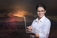 Enthusiastic responsible employee holding a laptop and smiling Stock Images