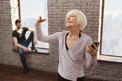 Enthusiastic retired woman enjoying music during the dance lesson Stock Images
