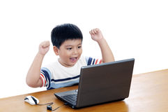 Enthusiastic Schoolboy With Laptop Royalty Free Stock Photography