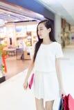 Enthusiastic shopping girl Royalty Free Stock Photos