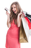 Enthusiastic shopping lady using credit or debit card Royalty Free Stock Photography
