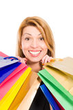 Enthusiastic shopping woman smiling Royalty Free Stock Photography