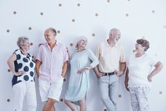 Enthusiastic smiling elderly people royalty free stock photos
