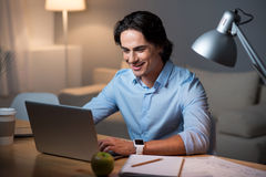 Enthusiastic smiling man using laptop. Stock Images