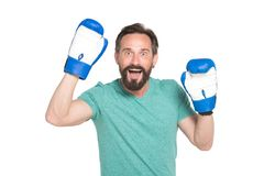 Enthusiastic smiling man wearing boxing gloves and keeping his hands up royalty free stock image