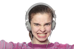 Enthusiastic teenage girl with headphones Royalty Free Stock Images