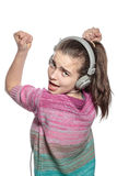 Enthusiastic teenage girl with headphones Stock Images