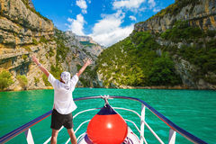 The enthusiastic tourist on  boat Royalty Free Stock Image