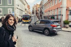 Enthusiastic traveler woman walking streets of european capital.Tourist in Lisbon,Portugal royalty free stock photos