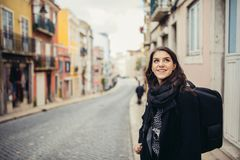 Enthusiastic traveler woman walking streets of european capital.Tourist in Lisbon,Portugal. Narrow, colorful,charming streets inviting curious woman tourist stock photos