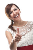 Enthusiastic woman giving a thumbs Stock Photography
