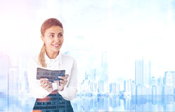 Enthusiastic woman with a planer, blue city Royalty Free Stock Photography