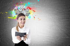Enthusiastic woman with a planer, brain cogs Stock Photos