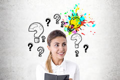 Enthusiastic woman with a planer, questions, idea Royalty Free Stock Photo