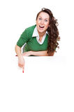 Enthusiastic woman pointing at copyspace Stock Photos
