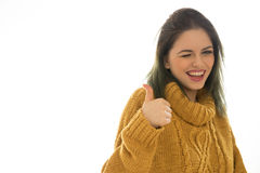 Enthusiastic woman winking and giving a thumbs up Royalty Free Stock Photos