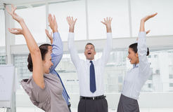Enthusiastic work team cheering together Royalty Free Stock Images