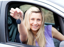 Enthusiastic young driver holding a key Stock Photos