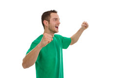 Enthusiastic young man in green isolated on white. Royalty Free Stock Photos