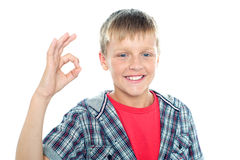 Enthusiastic young student flashing a perfect sign Royalty Free Stock Images
