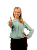 Enthusiastic young woman giving a thumbs up Royalty Free Stock Image
