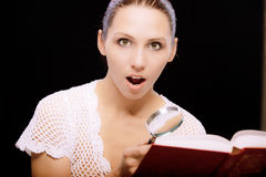 Enthusiastic young woman reads book Stock Photo