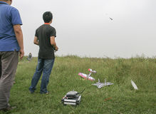 Enthusiasts with model plane Royalty Free Stock Photo