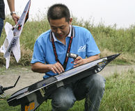 Enthusiasts with model plane Stock Images