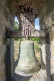Entire bell on bellfry Stock Photo