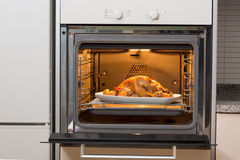 Entire chicken being cooked Stock Photography
