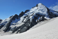 Entire north Face of the Dent d'Herens. View of the entire north face of the Dent d'Herens viewed from the Herens Pas in the Swiss Alps. In the middle of the Stock Photo