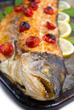 Entire salmon cooked with tomatoes ,lemon and laurel Stock Images