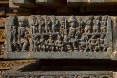 Entlastungen auf der äußeren Wand Hoysalesvara-Tempel, Halebid Lizenzfreie Stockfotos