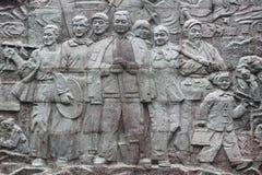 Entlastungsbild von chinesischen Arbeitskräften auf Stein Stockfotografie