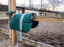 Entourage stables, horse green saddle blanket royalty free stock images