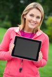Entraîneur de forme physique avec le PC de tablette images stock