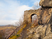 Entrace gate to Medieval castle ruins of Andelska Hora, aka Engelsburg, near Karlovy Vary, Czech Republic, Europe. Sunny and freezy winter day shot stock image