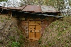 Entrada ao esconderijo subterrâneo Imagens de Stock Royalty Free