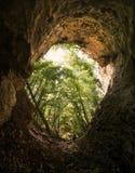 Entrada da caverna com homem Foto de Stock Royalty Free