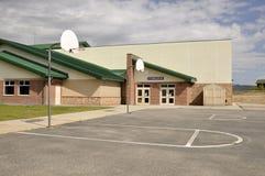Entrada del gimnasio de la construcción de escuelas Imágenes de archivo libres de regalías