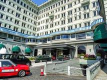 Entrada do hotel de luxo tradicional 'a península 'em Hong Kong foto de stock